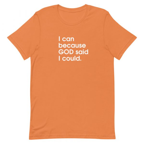 """A burnt orange unisex t-shirt with """"I can because God said I could"""" printed in white in the center of the shirt"""