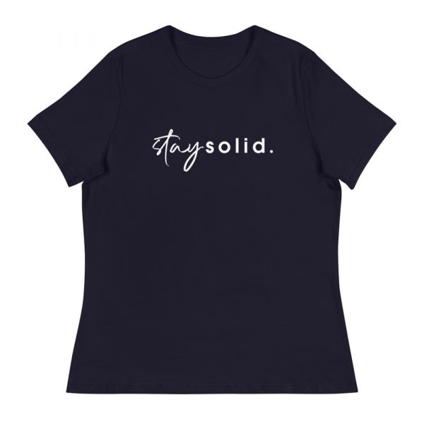 """A navy women's relaxed fit t-shirt with """"stay solid"""" printed in white in the center of the shirt"""