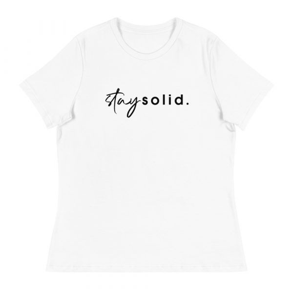 """A white women's relaxed fit t-shirt with """"stay solid"""" printed in black in the center of the shirt"""