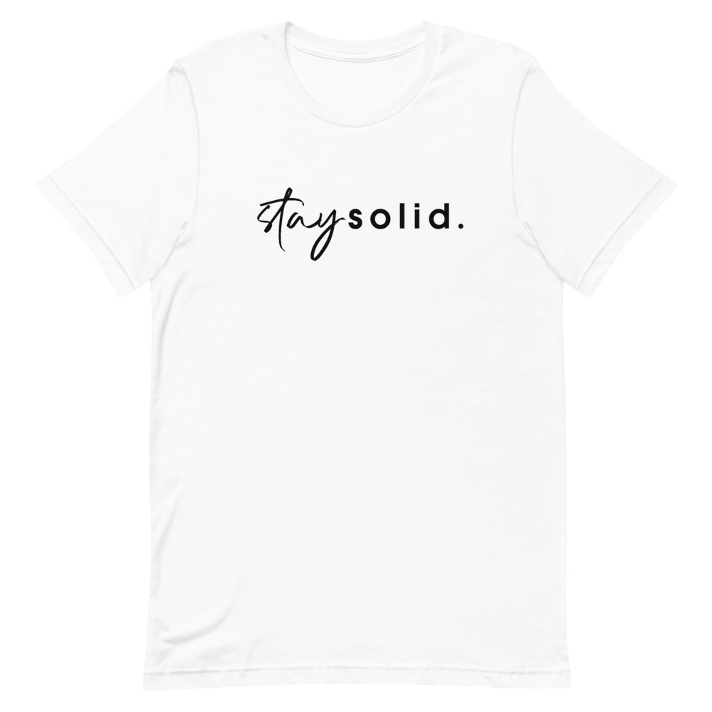 """A white unisex t-shirt with """"stay solid"""" printed in black in the center of the shirt"""