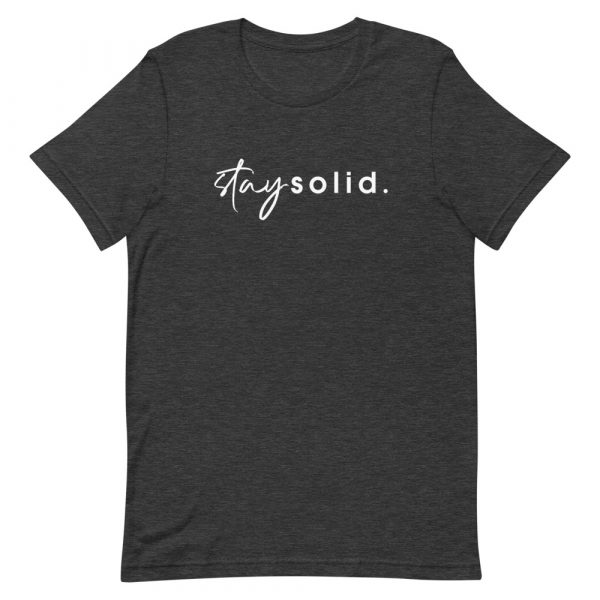 """A dark grey heather unisex t-shirt with """"stay solid"""" printed in white in the center of the shirt"""