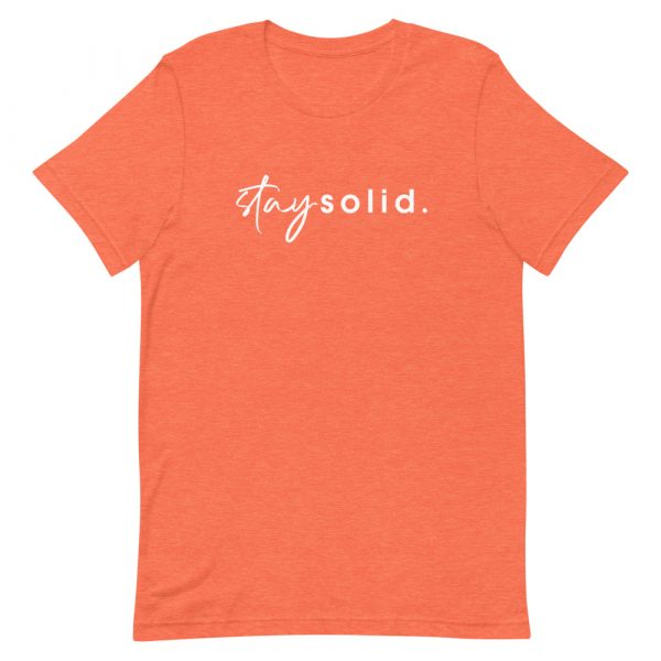 """A heather orange unisex t-shirt with """"stay solid"""" printed in white in the center of the shirt"""