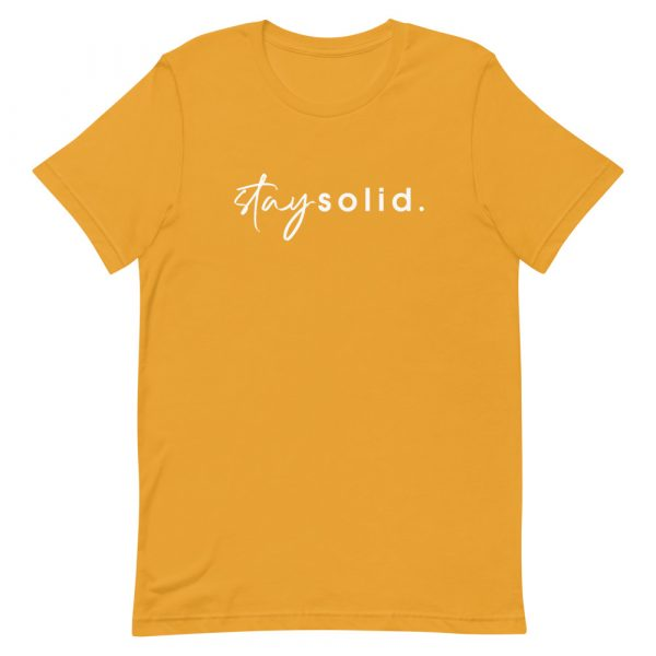 """A mustard unisex t-shirt with """"stay solid"""" printed in white in the center of the shirt"""