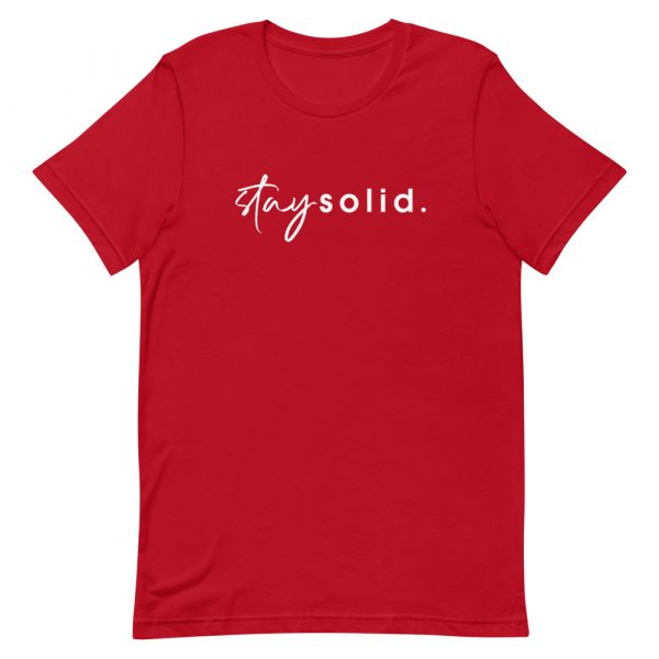 """A red unisex t-shirt with """"stay solid"""" printed in white in the center of the shirt"""